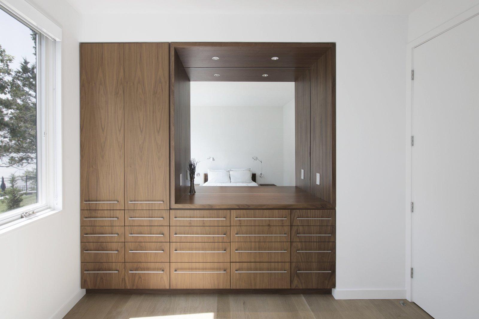 Bedroom, Wardrobe, Ceiling Lighting, Night Stands, Dresser, and Light Hardwood Floor Bedroom details  North Fork Bluff House by Resolution: 4 Architecture