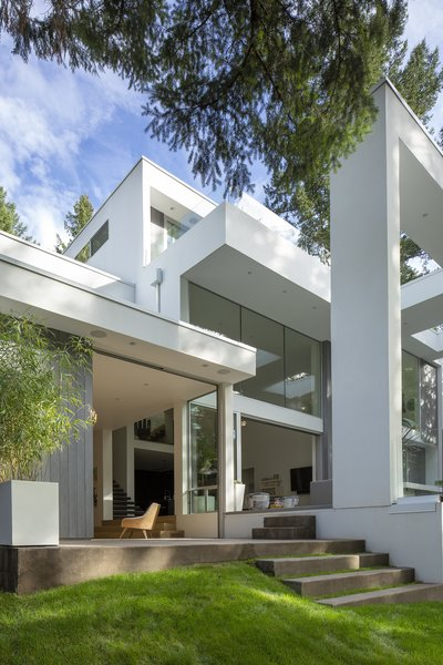 The home's great room can easily extend onto the outdoor deck thanks to glass walls that slide away.
