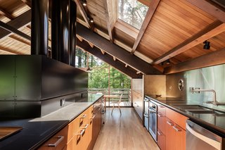 The renovation by architect Paul McKean opened up the kitchen to the rest of the living room, without losing the original furnace, which is part of the home's rustic-meets-modern charm.