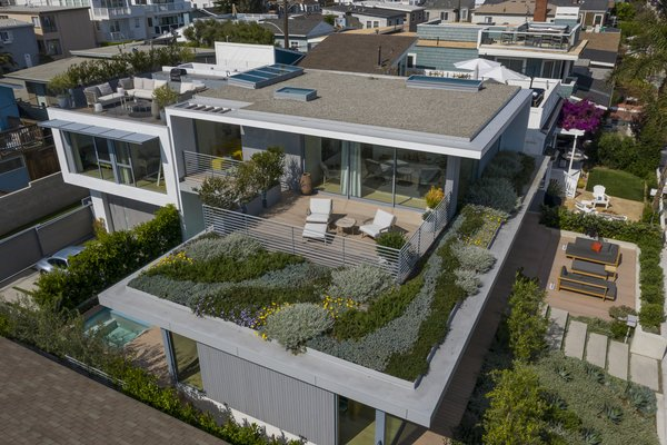 Viewed from above, the house shows off its multiple outdoor entertaining areas and lush vegetation