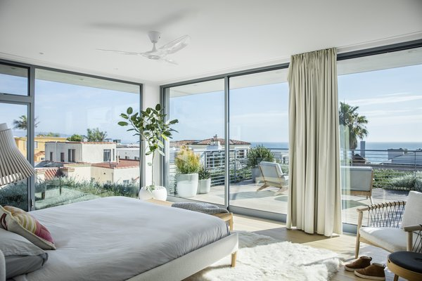 The master bedroom enjoys ocean views, with plantings providing a sense of lushness and a touch of privacy screening.