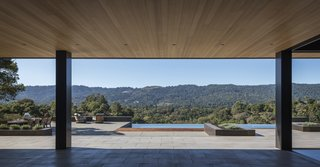 """""""When it's a beautiful spring day, you can open up the living, kitchen, and dining rooms and have them become one,"""" Wright says, noting how these spaces combine with an expansive outdoor deck and pool area."""