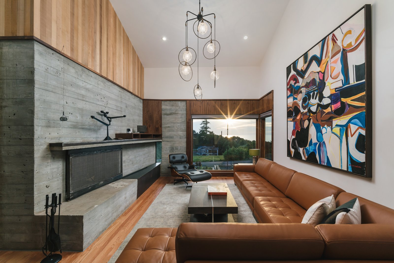 Arch Cape Residence by Colab Architecture + Design living room with board-formed concrete fireplace