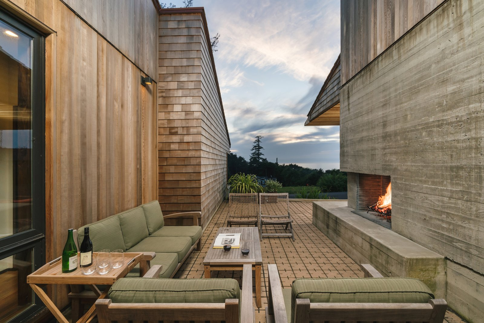 Arch Cape Residence by Colab Architecture + Design courtyard with outdoor fireplace
