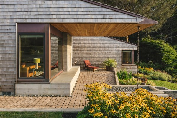 Thanks to the house's concrete sheer wall, the roof cantilevers 12 feet to provide shading for the living room and extend the couple's outdoor space.