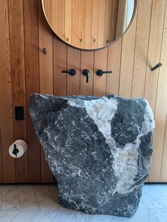 Homeowner and artist Elizabeth Paige Smith selected a large boulder to be made into the bathroom sink.