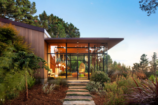 The home's glass addition was conceived as a place to be both indoors and outdoors at the same time.
