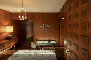 The home's interior envelops visitors in walnut and cherry wood panels.