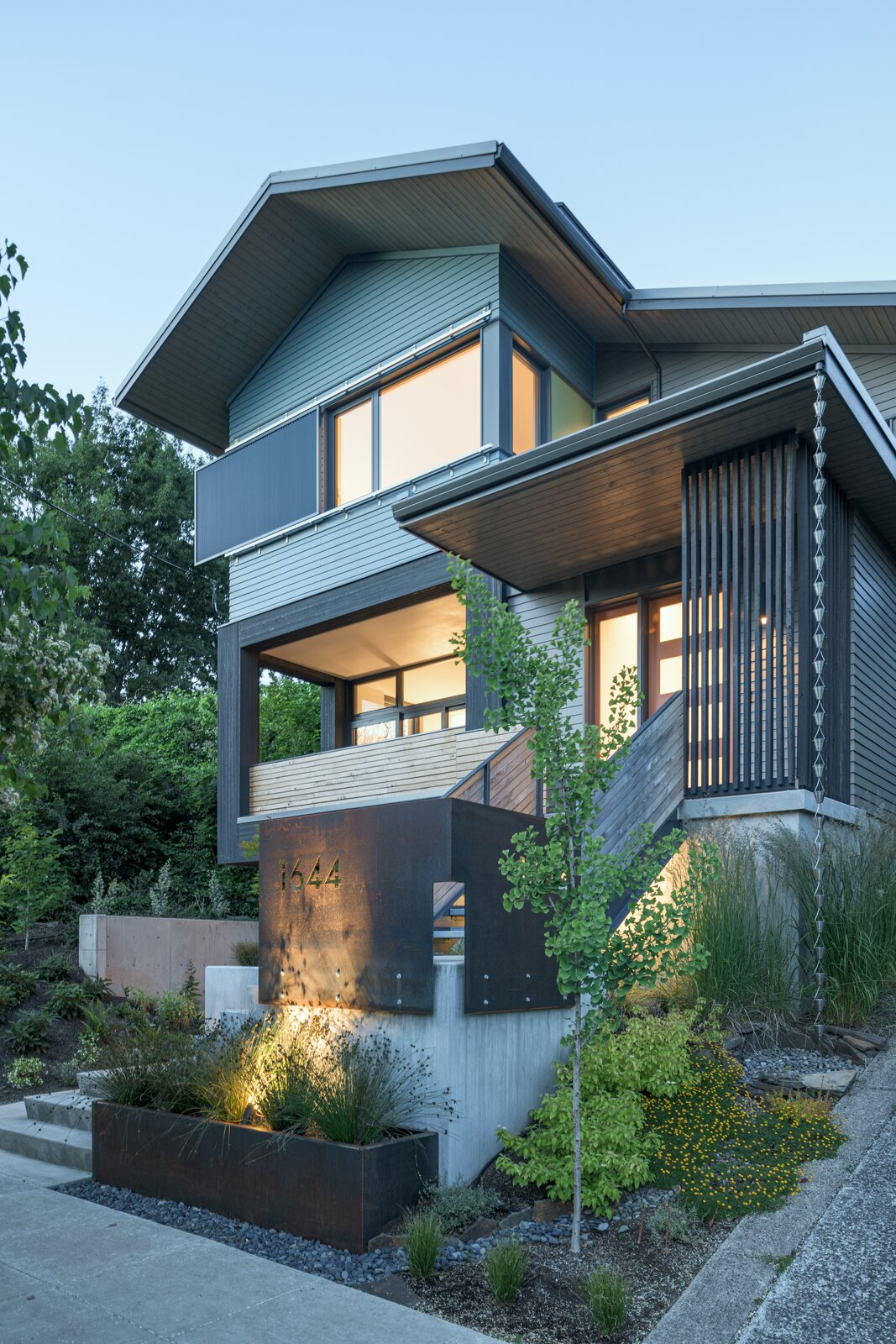 The Treehouse uses a combination of materials, native plants and design cues to break down its form into distinctive pieces.  Photo 1 of 9 in Budget Breakdown: An Architect Couple Build a Net-Zero Home and Studio for $250 Per Square Foot