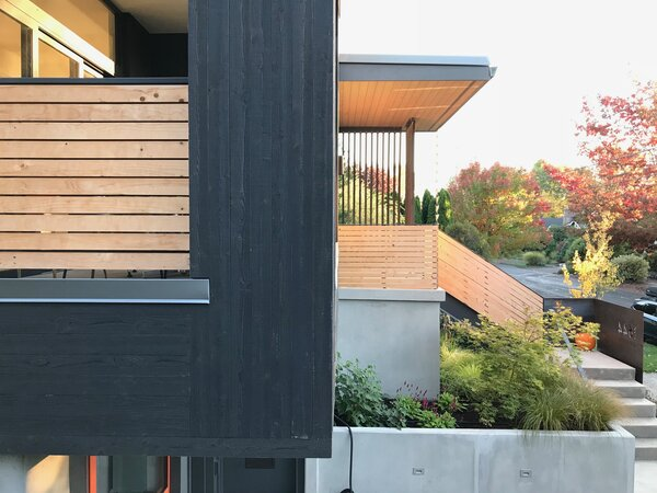 The home's cantilevered front balcony utilized pre-stained cedar to save money versus Shou Sugi Ban charred siding.