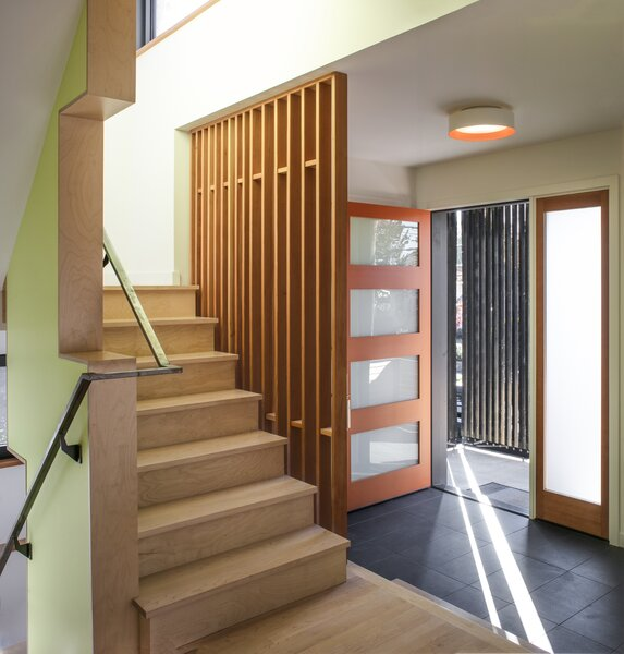 Although testing confirmed the home is as well-sealed as a certified Passive House, it's designed to be filled with light, including a frosted-glass front door and a stairway teeming with windows.