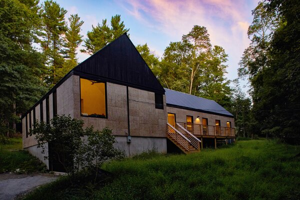 The home's exterior is clad in panels made from expanded corkboard—a sustainable, cost-effective material that provides insulation.
