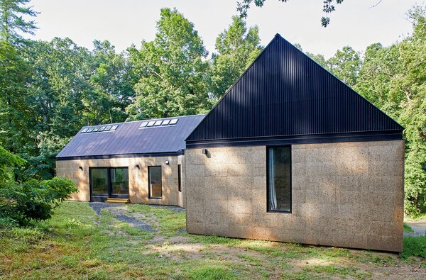 A corrugated metal roof and cork-panel siding were durable, cost-effective material choices, but their textures also recall those of the area's historic homes and agricultural buildings.