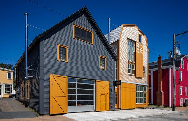 Both B2 Lofts buildings stretch across their small block, and thus face the street on two sides. MacKay-Lyons is especially fond of the interstitial space between buildings, clad in factory-style windows.