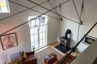 Crisscrossing steel cables give the apartments' vaulted ceilings extra structural support as well as aesthetic interest.