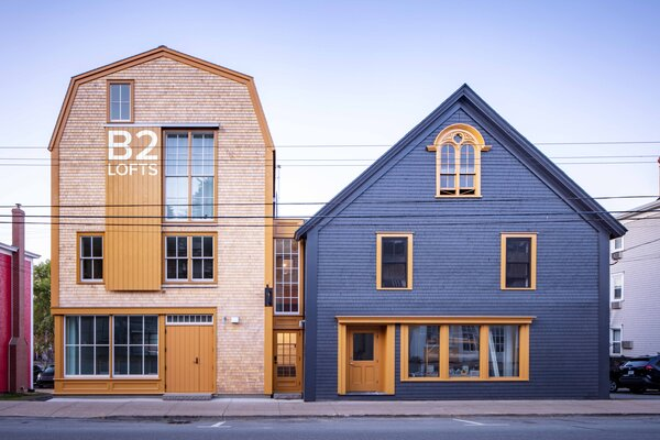In the historic center of Lunenburg, old and new mixed-use apartment buildings find common ground.