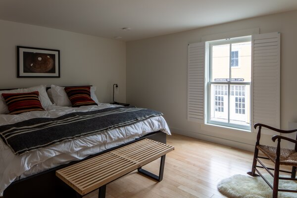 An upstairs apartment bedroom at the B2 Lofts with a view of the art school next door.
