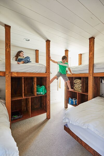 The ground floor includes a four-bed bunk room, allowing the Milford's two sons to bring friends.
