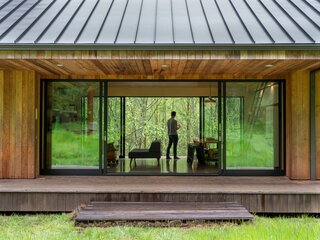 At 820 Square Feet, This Glass-Ensconced Cabin Feels Bigger Than It Is
