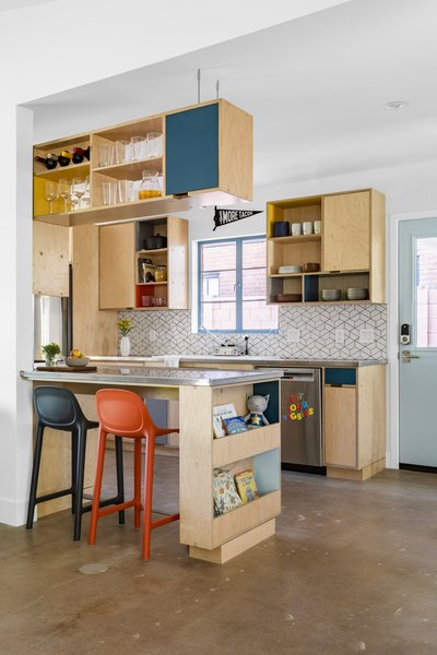 Kerf cabinetry, Heath Ceramics tile, and a BlueStar range complement stainless steel countertops and a porcelain sink in the kitchen.