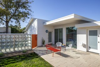 The homeowners designed the pool and the geometric barrier, made from a foam-cast cement breeze wall and iron swing gate.