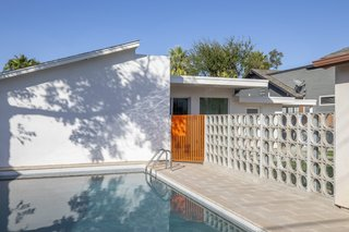 The homeowner designed the seven-foot-deep pool and concrete breeze wall themselves.