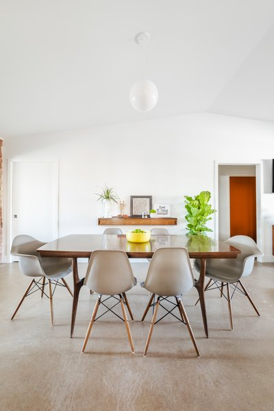 The dining room continues the home's midcentury aesthetic.