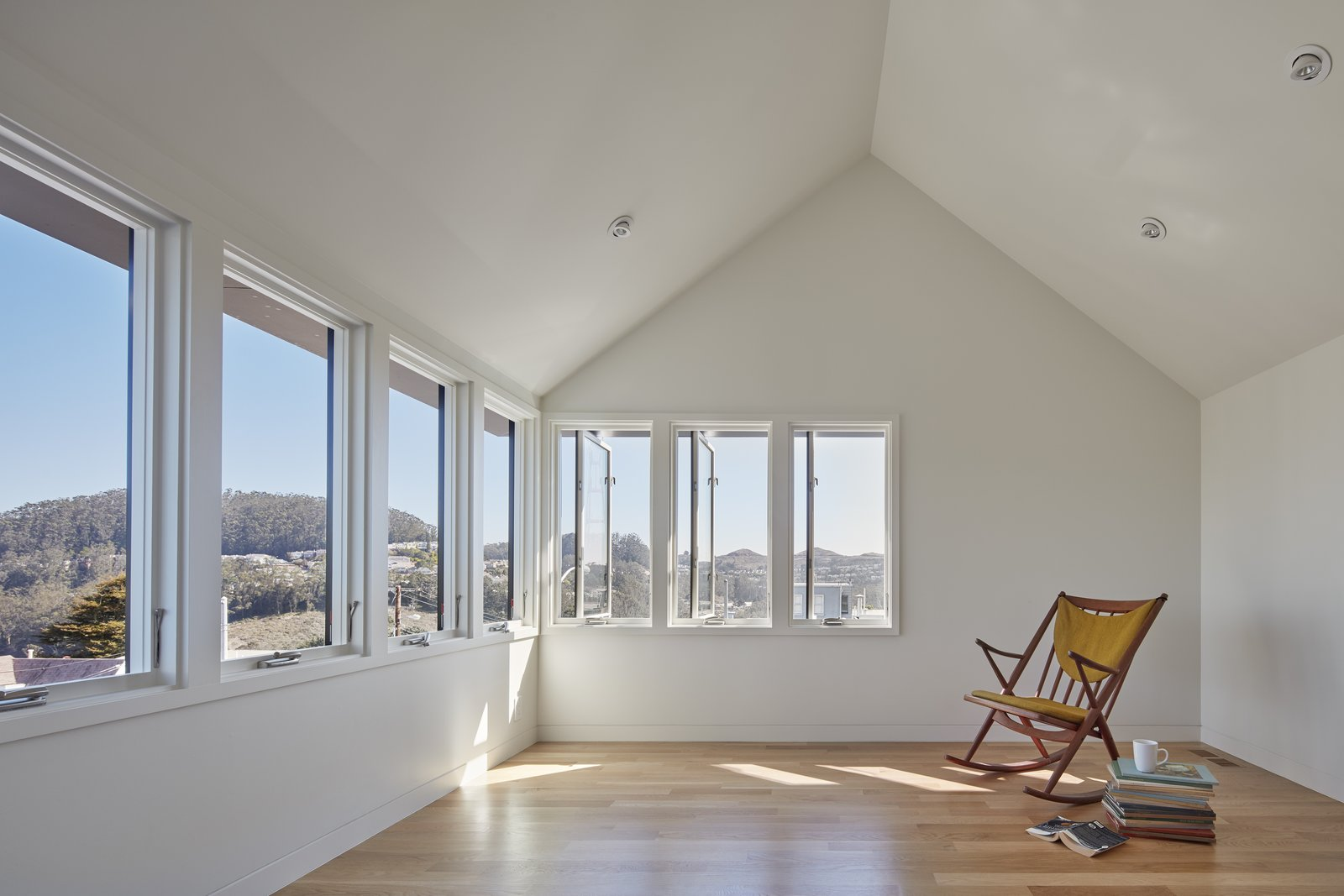 Sunny Vantage Point with Views Over the Bay  A-to-Z House by Spiegel Aihara Workshop