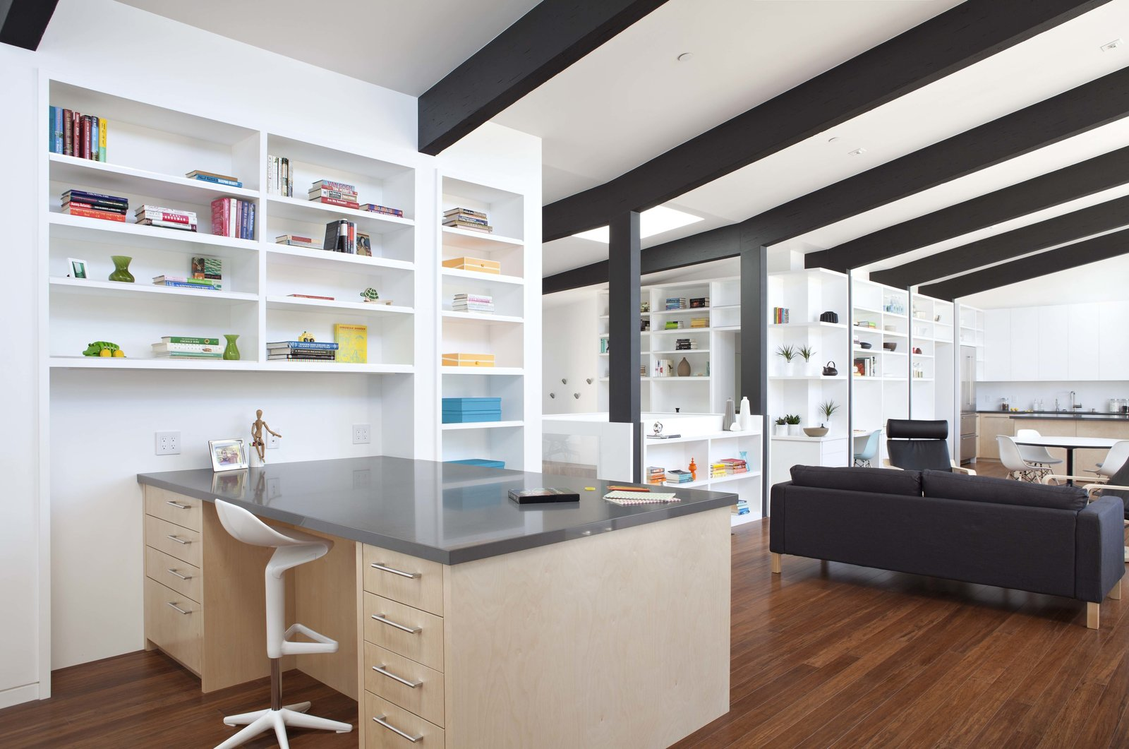 "Office, Study Room Type, Shelves, and Desk Net Zero Energy House   The goal, a new two-level home that could score as high as reasonable in the ""GreenPoint Rated System"". The owners de-constructed their existing home when they realized that any single-story design would completely eliminate their back yard.   Klopf Architecture"