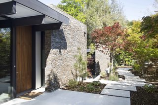 Modern Atrium House  The owners, inspired by mid-century modern architecture, hired Klopf Architecture to design an Eichler-inspired 21st-Century, energy efficient new home that would replace a dilapidated 1940s home. The home follows the gentle slope of the hillside while the overarching post-and-beam roof above provides an unchanging datum line. The changing moods of nature animate the house because of views through large glass walls at nearly every vantage point. Every square foot of the house remains close to the ground creating and adding to the sense of connection with nature.