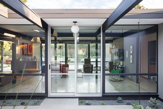 """Renewed Classic Eichler Remodel  Klopf Architecture, Growsgreen Landscape Design, and Flegel's Construction partnered to bring this mid-century atrium Eichler home up to 21st century standards. Together with the owners, Geoff Campen and the Klopf Architecture team carefully integrated elements and ideas from the mid-century period without making the space seem dated. They entrusted Klopf Architecture to respectfully expand and update the home, while still keeping it """"classic"""". The Klopf team helped them open up the kitchen, dining, and living spaces into one flowing great room, expand the master suite, replace the kitchen and bathrooms, and provide additional features like an office and powder room, all while maintaining the mid-century modern style of this Silicon Valley home."""