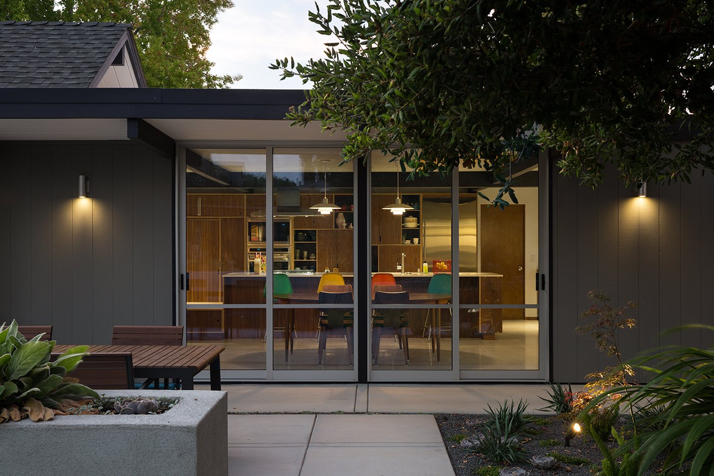 "Exterior and Mid-Century Building Type Renewed Classic Eichler Remodel  Klopf Architecture, Growsgreen Landscape Design, and Flegel's Construction partnered to bring this mid-century atrium Eichler home up to 21st century standards. Together with the owners, Geoff Campen and the Klopf Architecture team carefully integrated elements and ideas from the mid-century period without making the space seem dated. They entrusted Klopf Architecture to respectfully expand and update the home, while still keeping it ""classic"". The Klopf team helped them open up the kitchen, dining, and living spaces into one flowing great room, expand the master suite, replace the kitchen and bathrooms, and provide additional features like an office and powder room, all while maintaining the mid-century modern style of this Silicon Valley home.   Klopf Architecture"