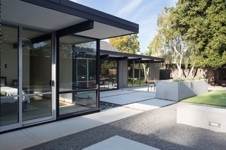 "Renewed Classic Eichler Remodel  Klopf Architecture, Growsgreen Landscape Design, and Flegel's Construction partnered to bring this mid-century atrium Eichler home up to 21st century standards. Together with the owners, Geoff Campen and the Klopf Architecture team carefully integrated elements and ideas from the mid-century period without making the space seem dated. They entrusted Klopf Architecture to respectfully expand and update the home, while still keeping it ""classic"". The Klopf team helped them open up the kitchen, dining, and living spaces into one flowing great room, expand the master suite, replace the kitchen and bathrooms, and provide additional features like an office and powder room, all while maintaining the mid-century modern style of this Silicon Valley home."