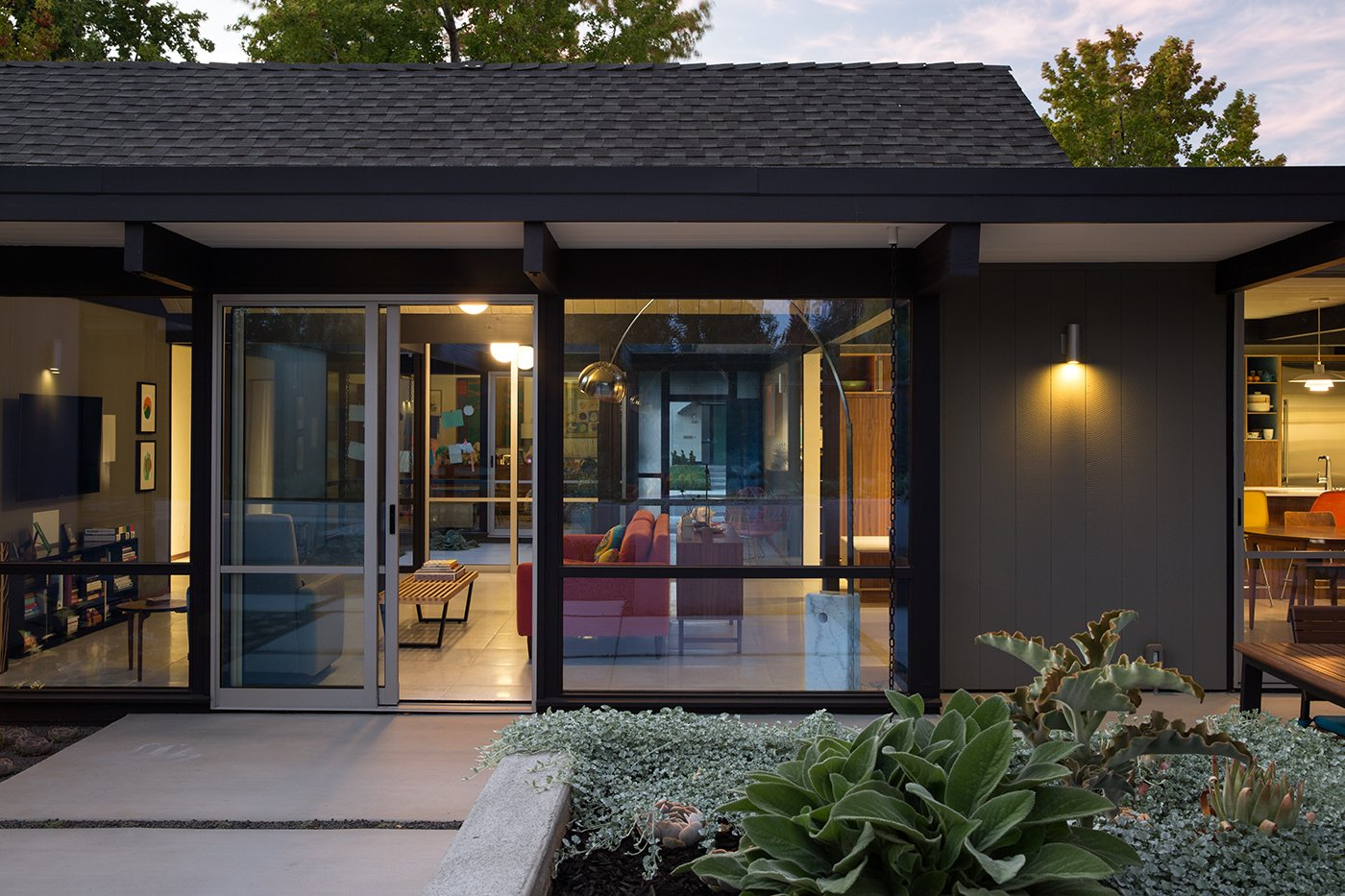 """Exterior, Mid-Century Building Type, and House Building Type Renewed Classic Eichler Remodel  Klopf Architecture, Growsgreen Landscape Design, and Flegel's Construction partnered to bring this mid-century atrium Eichler home up to 21st century standards. Together with the owners, Geoff Campen and the Klopf Architecture team carefully integrated elements and ideas from the mid-century period without making the space seem dated. They entrusted Klopf Architecture to respectfully expand and update the home, while still keeping it """"classic"""". The Klopf team helped them open up the kitchen, dining, and living spaces into one flowing great room, expand the master suite, replace the kitchen and bathrooms, and provide additional features like an office and powder room, all while maintaining the mid-century modern style of this Silicon Valley home.   Klopf Architecture"""
