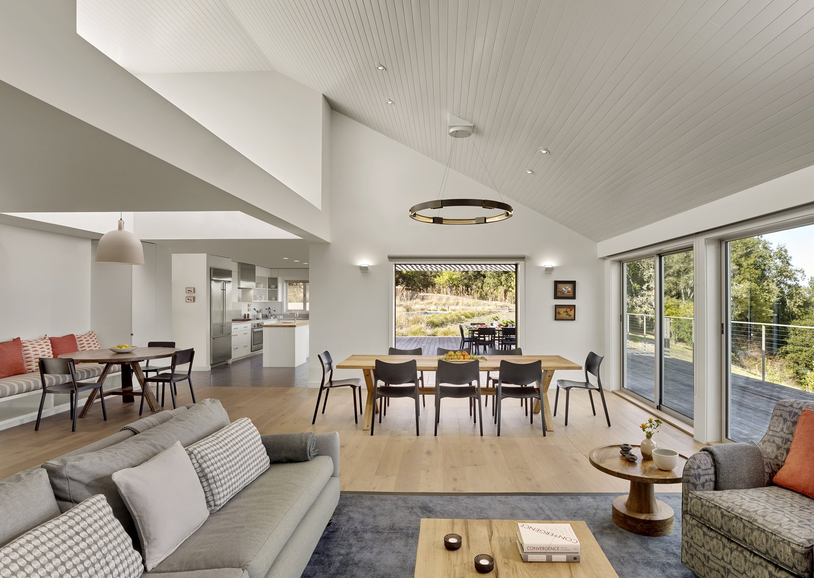 Dining Room, Ceiling Lighting, Storage, Bench, Chair, Table, Ceramic Tile Floor, Pendant Lighting, Medium Hardwood Floor, Wall Lighting, Recessed Lighting, Gas Burning Fireplace, Shelves, and Lamps Orchard House Interior  Orchard House by Cary Bernstein Architect