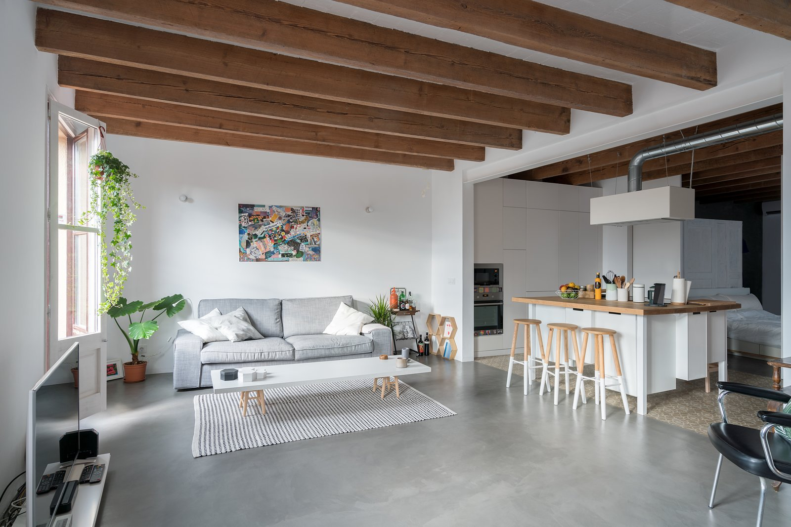 White Cabinet, Chair, Concrete Floor, Porcelain Tile Floor, Wood Counter, Living Room, Sofa, and Coffee Tables Living Room  Old Town Refurbishment by Habitan Architects