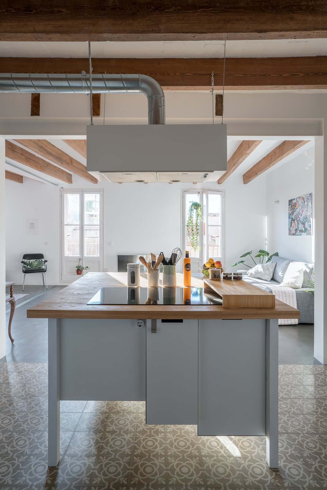 Kitchen, Ceramic Tile Floor, Wood Counter, and White Cabinet Kitchen Table  Old Town Refurbishment by Habitan Architects