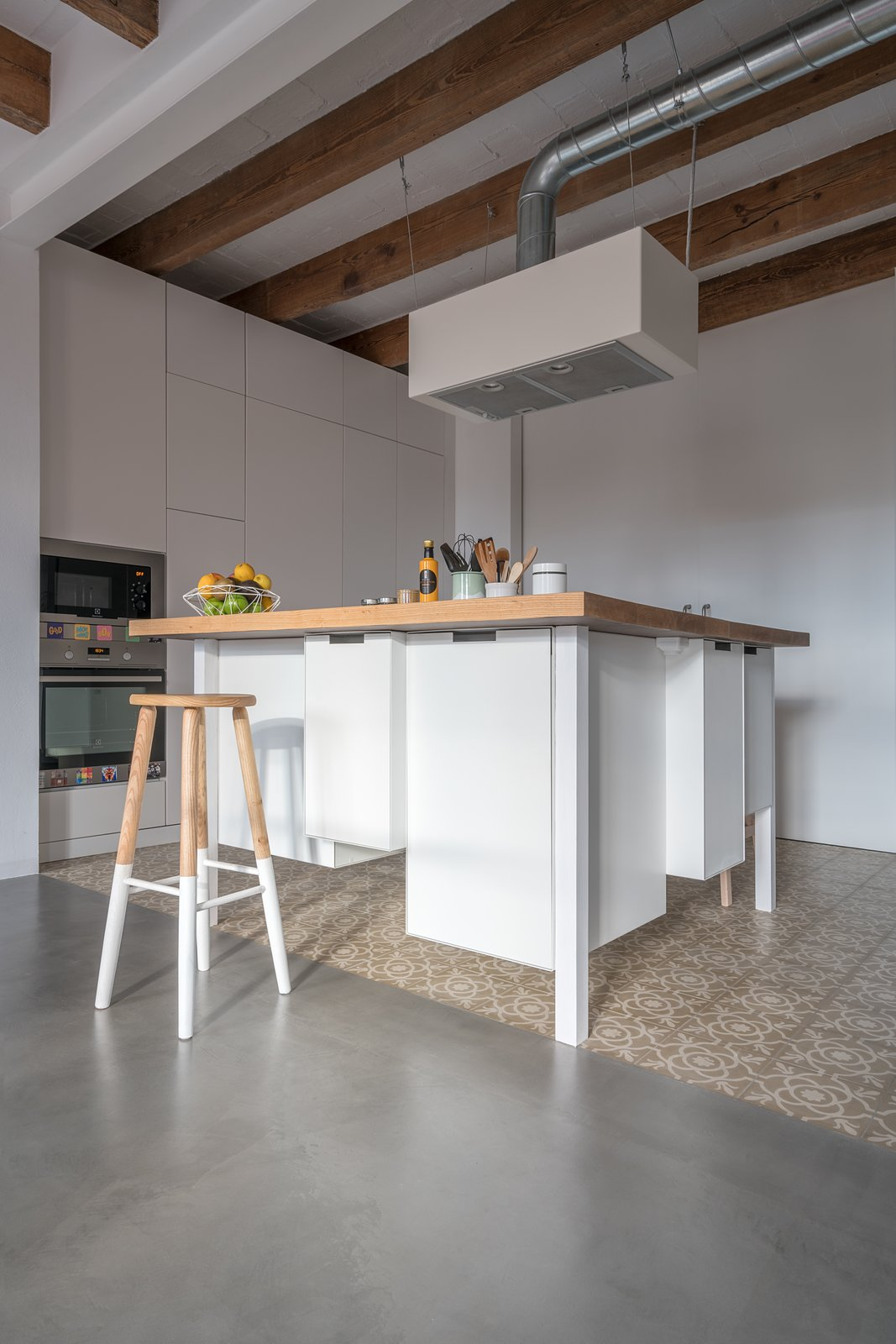 Kitchen, Wood Counter, White Cabinet, and Ceramic Tile Floor Kitchen Table  Old Town Refurbishment by Habitan Architects