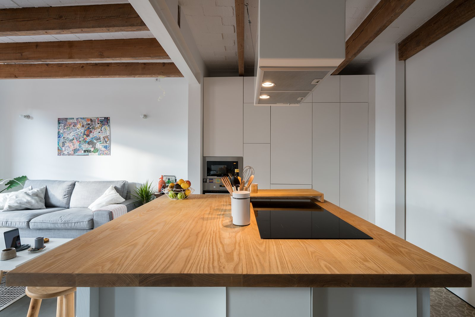 Kitchen, Ceramic Tile Floor, White Cabinet, Wood Cabinet, and Wood Counter Kitchen Table  Old Town Refurbishment by Habitan Architects