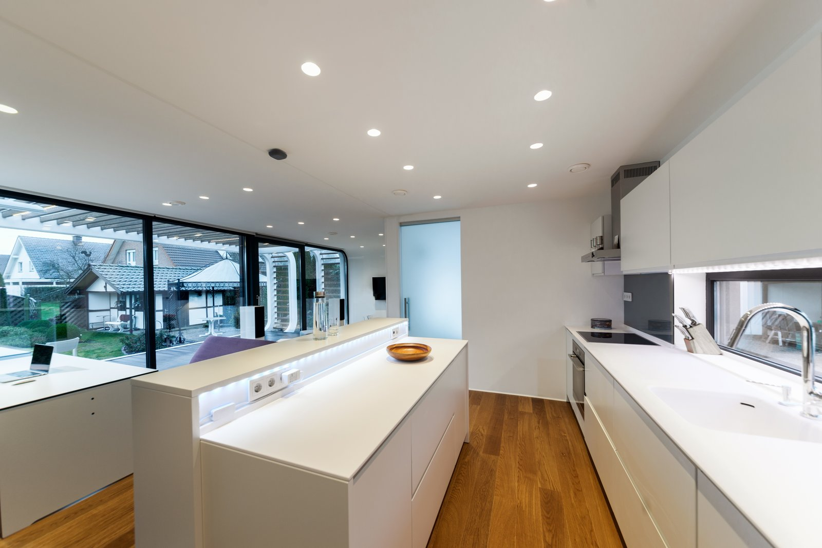 Kitchen, White Cabinet, Medium Hardwood Floor, Drop In Sink, Cooktops, Range Hood, Wall Oven, and Recessed Lighting Coodo 64 comes equipped with a full kitchen, bathroom, and bedroom.  Photo 3 of 12 in Meet the Prefab Unit That's Smart, Mobile, and Sustainable