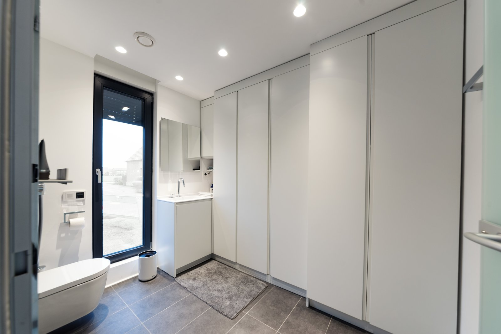 Bath Room, Recessed Lighting, One Piece Toilet, Drop In Sink, and Rug Floor Coodo 64's bathroom has built-in storage.  Photo 6 of 12 in Meet the Prefab Unit That's Smart, Mobile, and Sustainable