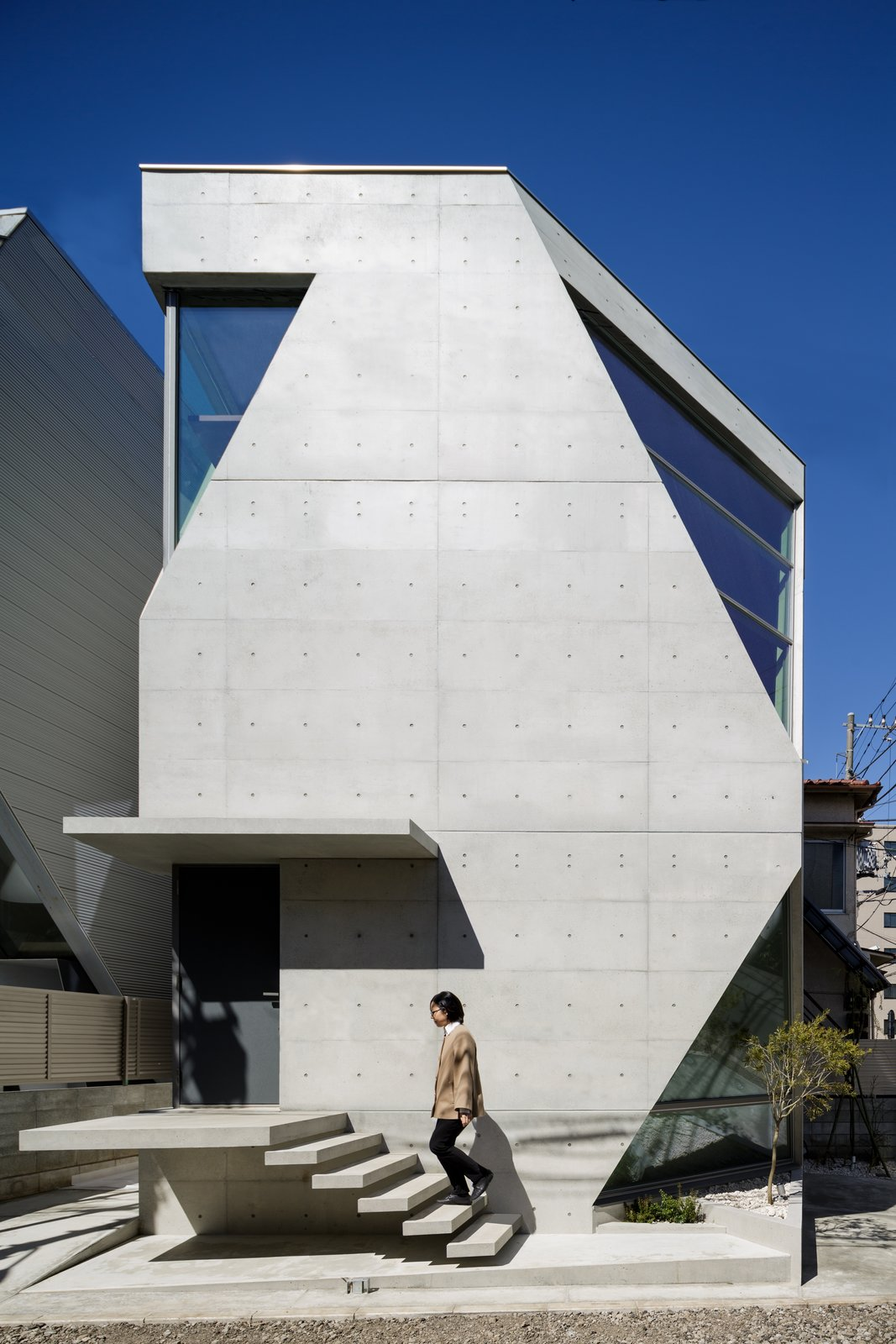 Exterior, House Building Type, Concrete Siding Material, and Glass Siding Material Built with specially-formulated concrete made of volcanic ash, this micro-house in Tokyo maximizes space through vertical construction.  When Tokyo-based architecture firm Atelier TEKUTO received a brief from their clients to build a distinctive, environmentally-conscious concrete home, they embarked on a two-and-a-half year journey of spacial and material exploration. Built in 2015, the result—the R Torso C project—recently won the Overall Excellence Award and first place in the low-rise buildings category at the 2017 American Concrete Institute Awards.  Best Photos from 25 Modern Homes That Kill it With Concrete