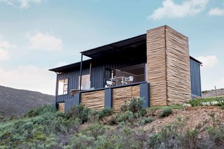 Nestled on a family farm, this South African shipping-container cabin is completely off the grid. Located on owner Lucas Steyn's family farm in Botrivier, a 90-minute drive from Capetown, Copia is an eco-retreat comprised of two shipping-container cabins in the South African countryside.