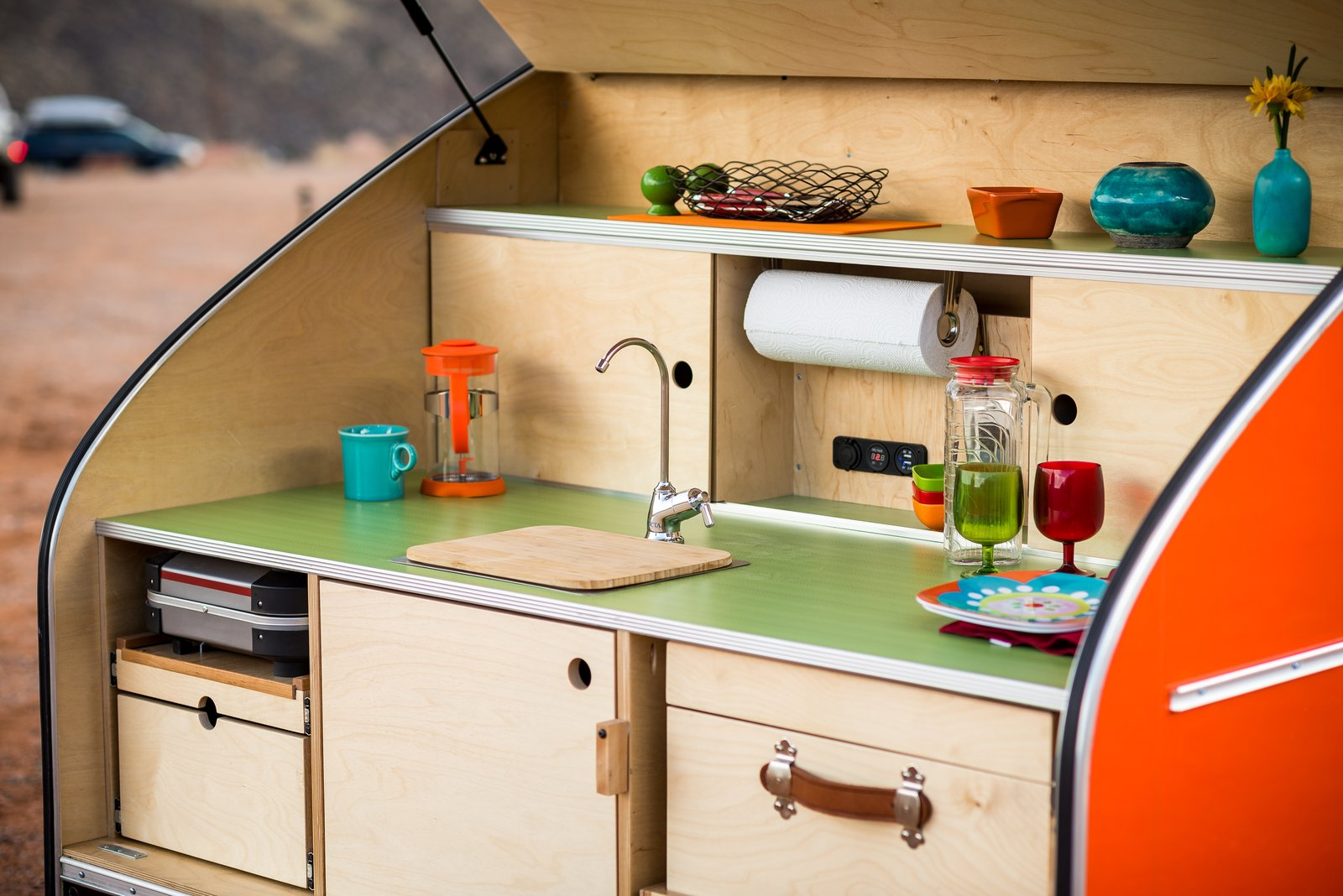 Kitchen, Wood, Wood, Drop In, and Wood The trailer features an integrated electrical system, running water, and a custom-built cooler.  Best Kitchen Wood Wood Drop In Wood Photos from Timberleaf Trailers
