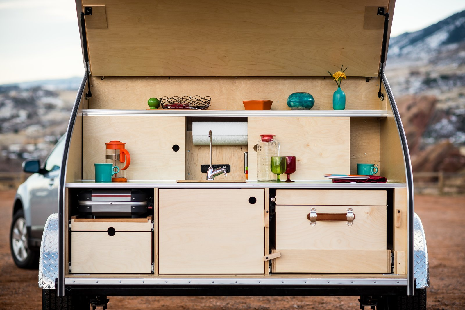 Kitchen, Wood, Drop In, Wood, Wood, and Laminate The galley allows you to cook outdoors in style.  Best Kitchen Wood Wood Wood Photos from Timberleaf Trailers