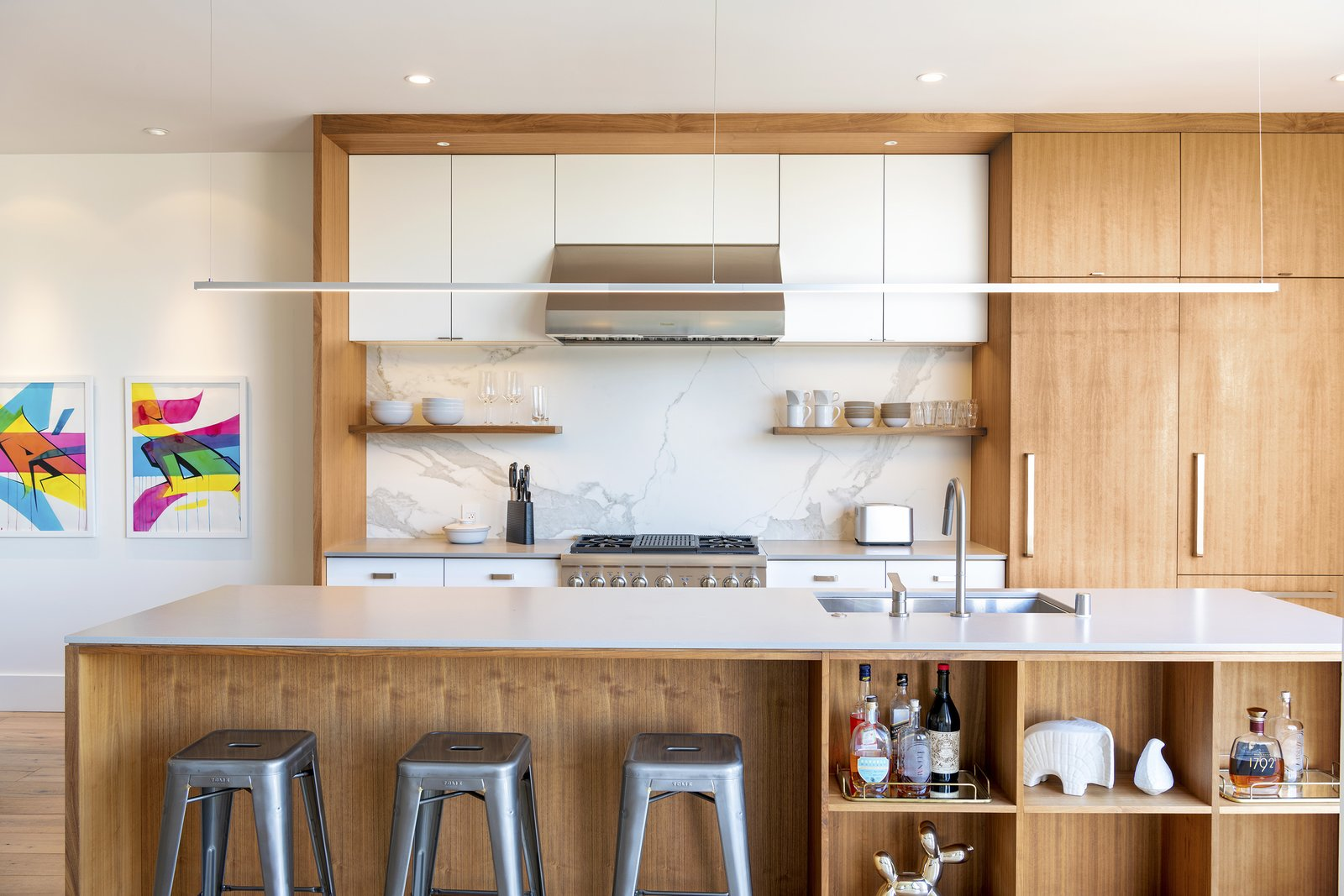 Kitchen, Concrete Counter, Light Hardwood Floor, Marble Backsplashe, Ceiling Lighting, Wood Cabinet, Refrigerator, and Drop In Sink Kitchen  Precita Park Residence by Studio Sarah Willmer, Architecture