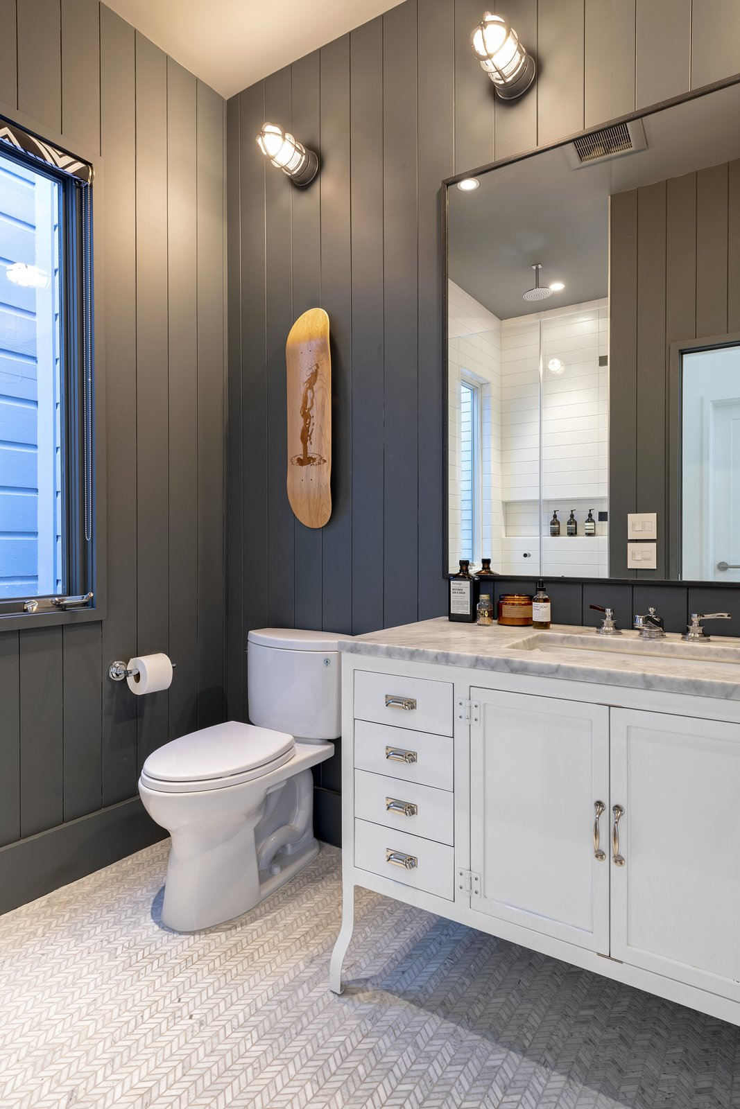 Bath Room, Drop In Sink, Marble Counter, Ceramic Tile Floor, and Wall Lighting Guest Bath  Precita Park Residence by Studio Sarah Willmer, Architecture