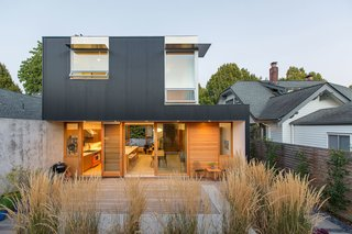 "Nestled in Seattle's East Capitol Hill neighborhood, this modern residence ""is an economical, efficient, low-maintenance, and modern version of a traditional Seattle house—one with primary living spaces on the main floor and three bedrooms above,"" state the architects."
