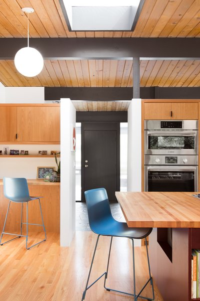 The front door leads straight into the kitchen, a central gathering place.