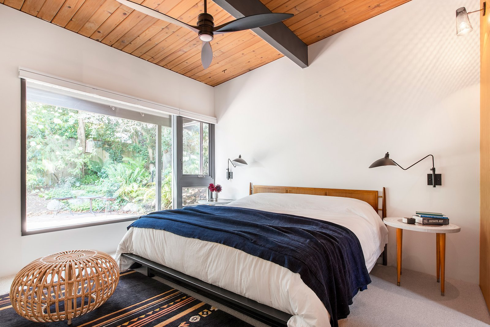 Bedroom, Bed, Night Stands, Wall, Rug, and Carpet The revamp also comprised of reworking the layout of the master suite. However, the windows and original wood ceilings were maintained for warmth and light.    Best Bedroom Bed Rug Carpet Photos from Hillside Midcentury